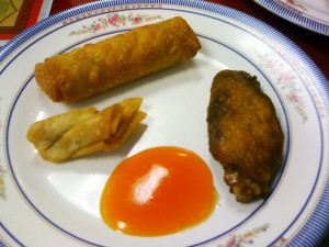 Appetizers - Chicken Pot Stickers, Egg Roll, Fried Chicken, and a spoonful of sweet and sour sauce